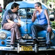Cuba havana men on blue car